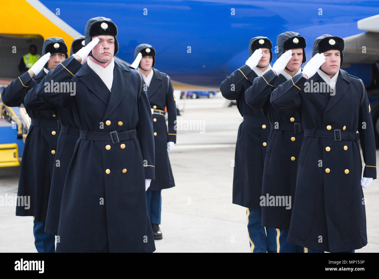 Soldiers assigned to the 3d U.S. Infantry Regiment (The Old Guard), conduct a Plane Side Honors at Ronald Reagan Washington National Airport in Arlington, Va., March 14, 2018. Honors were rendered for Sgt. 1st Class Ryan Kenner who perished while serving on Active Duty. - Stock Image