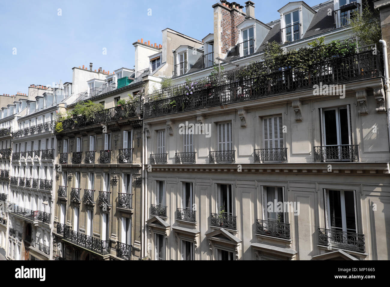 Exterior view of a row of apartment buildings with plants on balconies in the Rue Pierre Semard Paris 9th arrondissemnt France Europe EU  KATHY DEWITT - Stock Image
