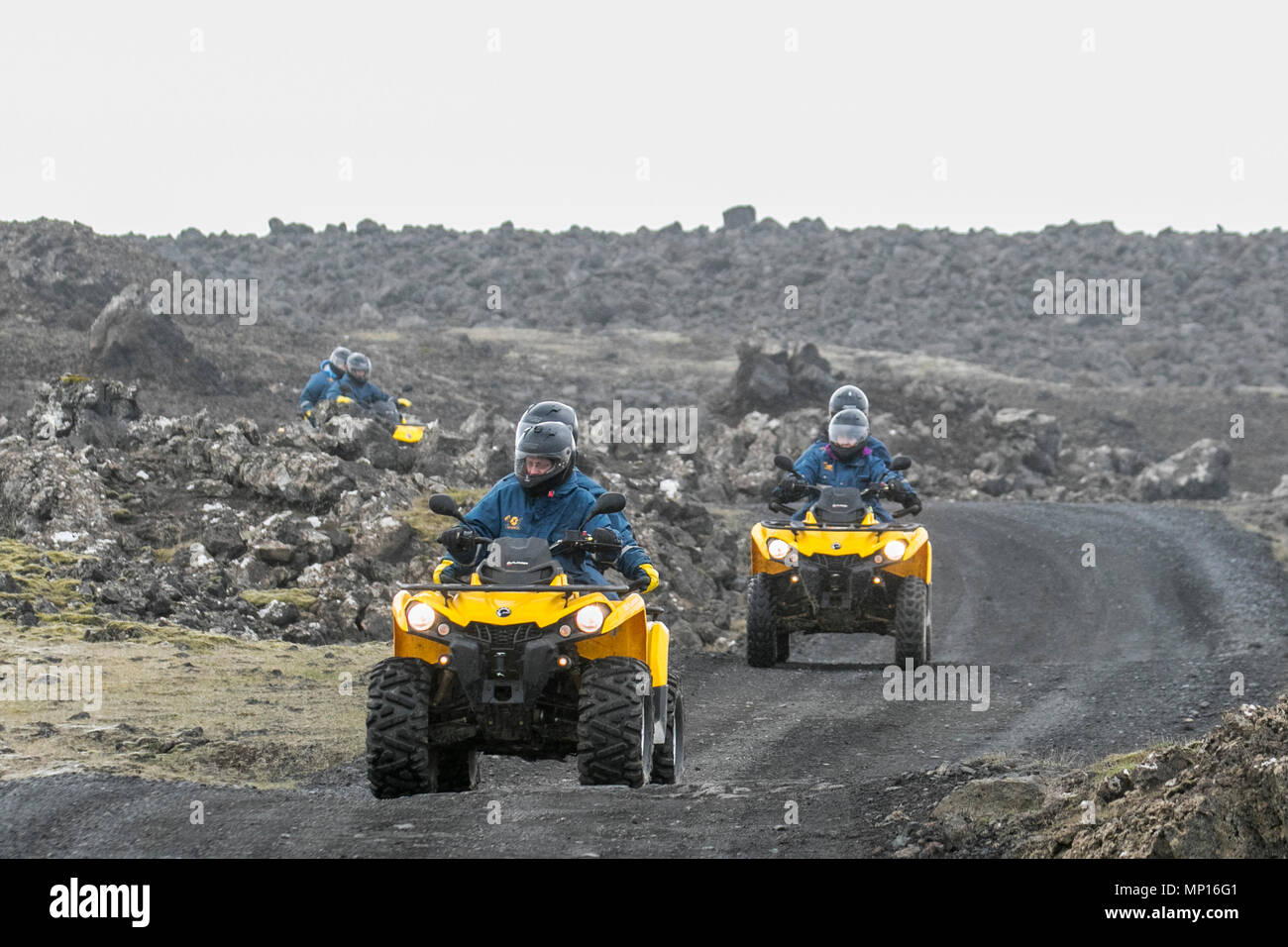 BRP outlander ATVS quads, atv, quad, bike, sport, vehicle, extreme, adventure, race, speed, road, dirt, wheel, motocross, terrain, motor, outdoor, riding, transportation, offroad, competition, motorcycle, power, rider, transport, fun, helmet, active, 4x4, motorbike, mud, man, action, off-road, sand, sports, leisure, trail, dangerous, driving, desert, track, racer, drive, ride, off road use on training run at Grindavik, Iceland, UK - Stock Image