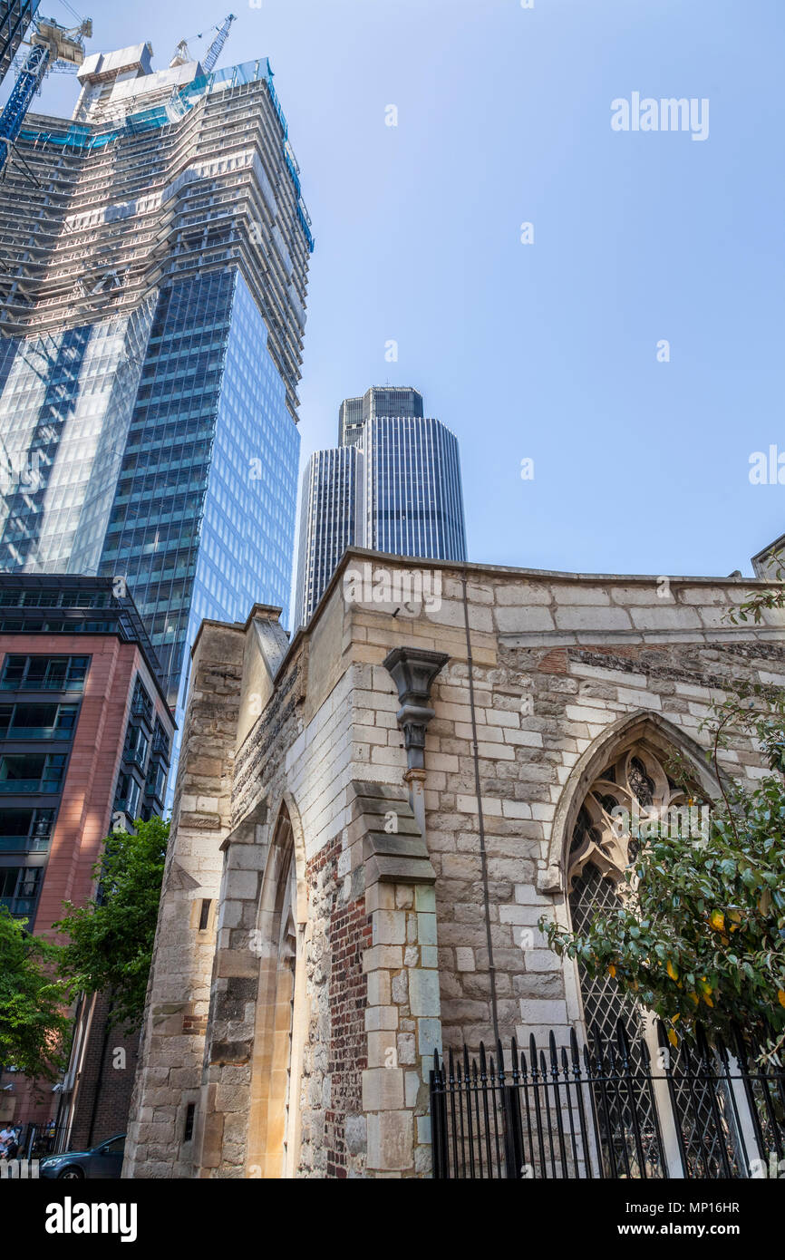 St Helen's Church, Bishopsgate in the foreground with 22 Bishopsgate under construction and Tower 42 in the City of London - Stock Image