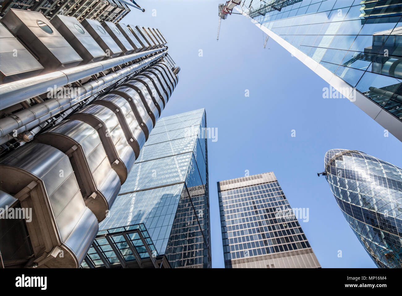 Looking up at the Lloyds Building (left), the Leadenhall Building, 122 Leadenhall Street, the Gherkin and the Scalpel in London. - Stock Image