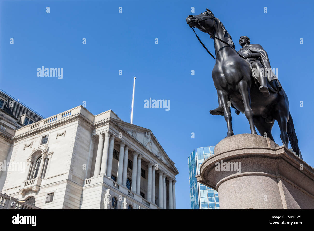 Bank of England on Threadneedle Street in the heart of London's financial district, with Duke of Wellington statue in the foreground - Stock Image