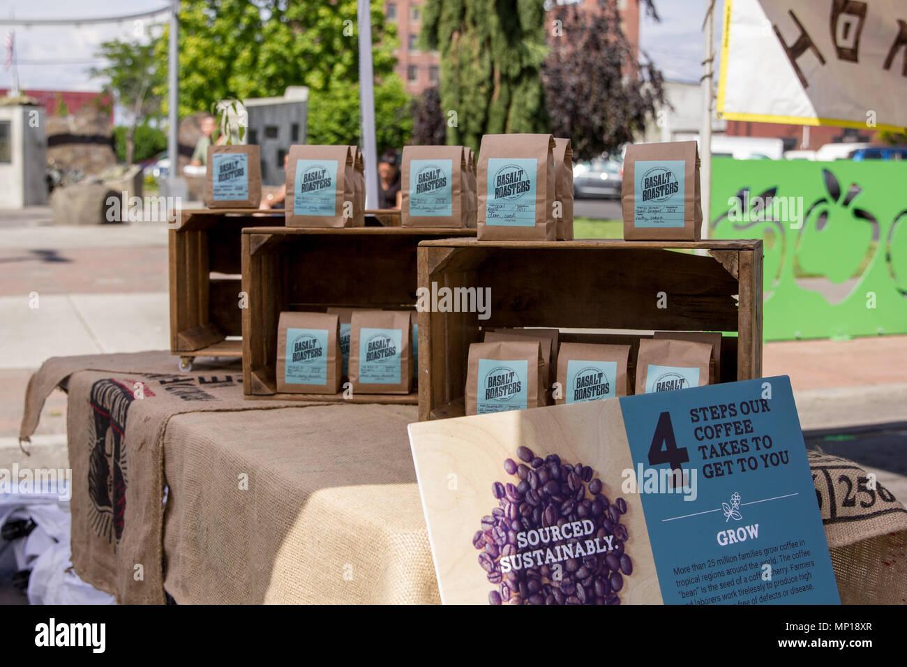 Yakima, Washington / USA - May 21, 2018: Basalt Roasters sell their single origin coffee at the downtown farmer's market on Sunday morning. - Stock Image