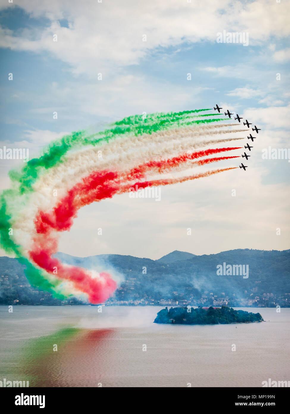 The Italian Aerobatic Display Team the Frecce Tricolori formation flying over the Lake Maggiore, Verbania, Italy Stock Photo