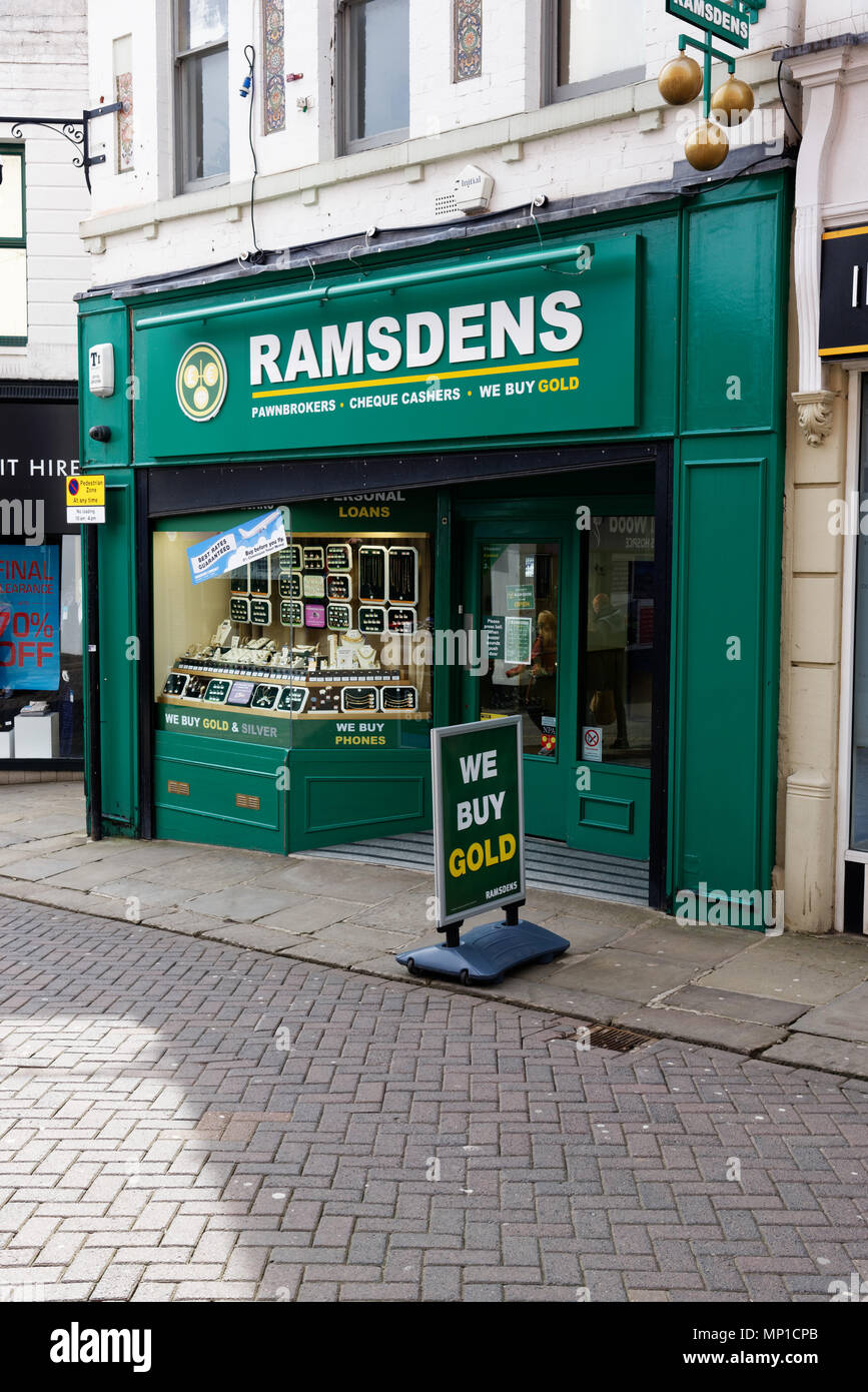 A branch of Ramsdens pawnbrokers in Chesterfield, Derbyshire, England with a sign saying We Buy Gold outside - Stock Image