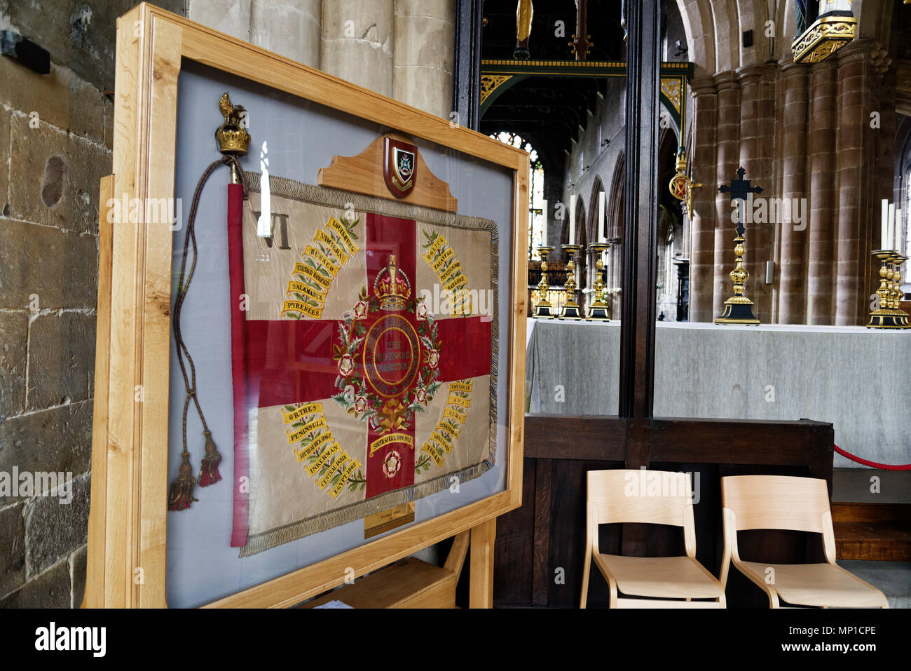 The colours of the 6th Batallion Sherwood Foresters regiment in Chesterfield parish church showing 19th century battles such as Sebastopol, Abyssinia  - Stock Image