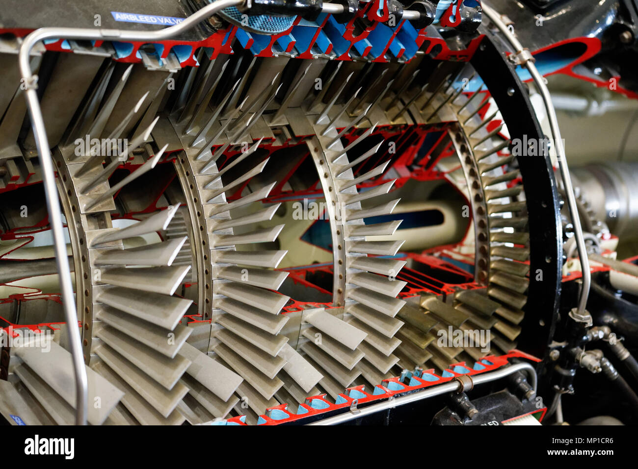 A cutaway model of a jet engine showing the turbine blades - Stock Image
