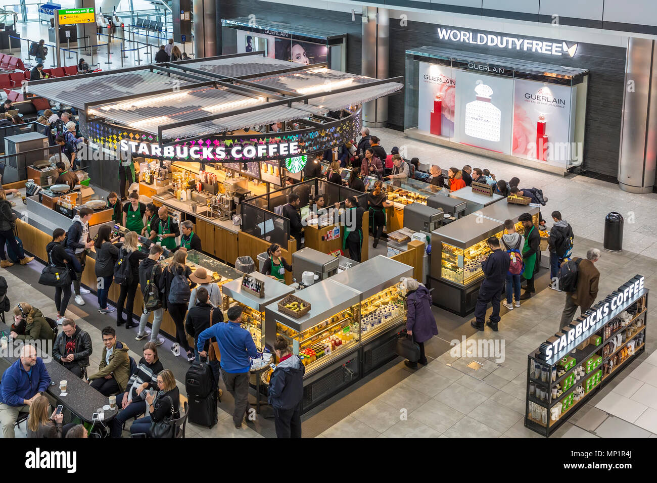 Starbucks Coffee And Duty Free Sign At Heathrow Airport