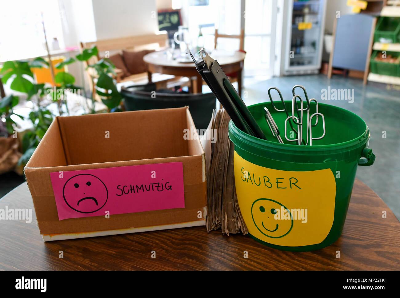 16 May 2018, Germany, Berlin: Two trays for 'schmutzig' (lit. dirty) and 'sauber' (lit. clean) utensils which can be used for bottling the products at the zero waste shop 'Der Sache wegen - einfach richtig einkaufen' (lit. For the cause - simply shop right) at Lychener Strasse in the district of Prenzlauber Berg. The shop sells food and household goods like detergents and soap. The products are free of plastic, free of palm-oil, organic, regional, fair, conscious and no animals suffer for them or comply with the current ecological alternative. Food is being sold in reusable containers and fill - Stock Image