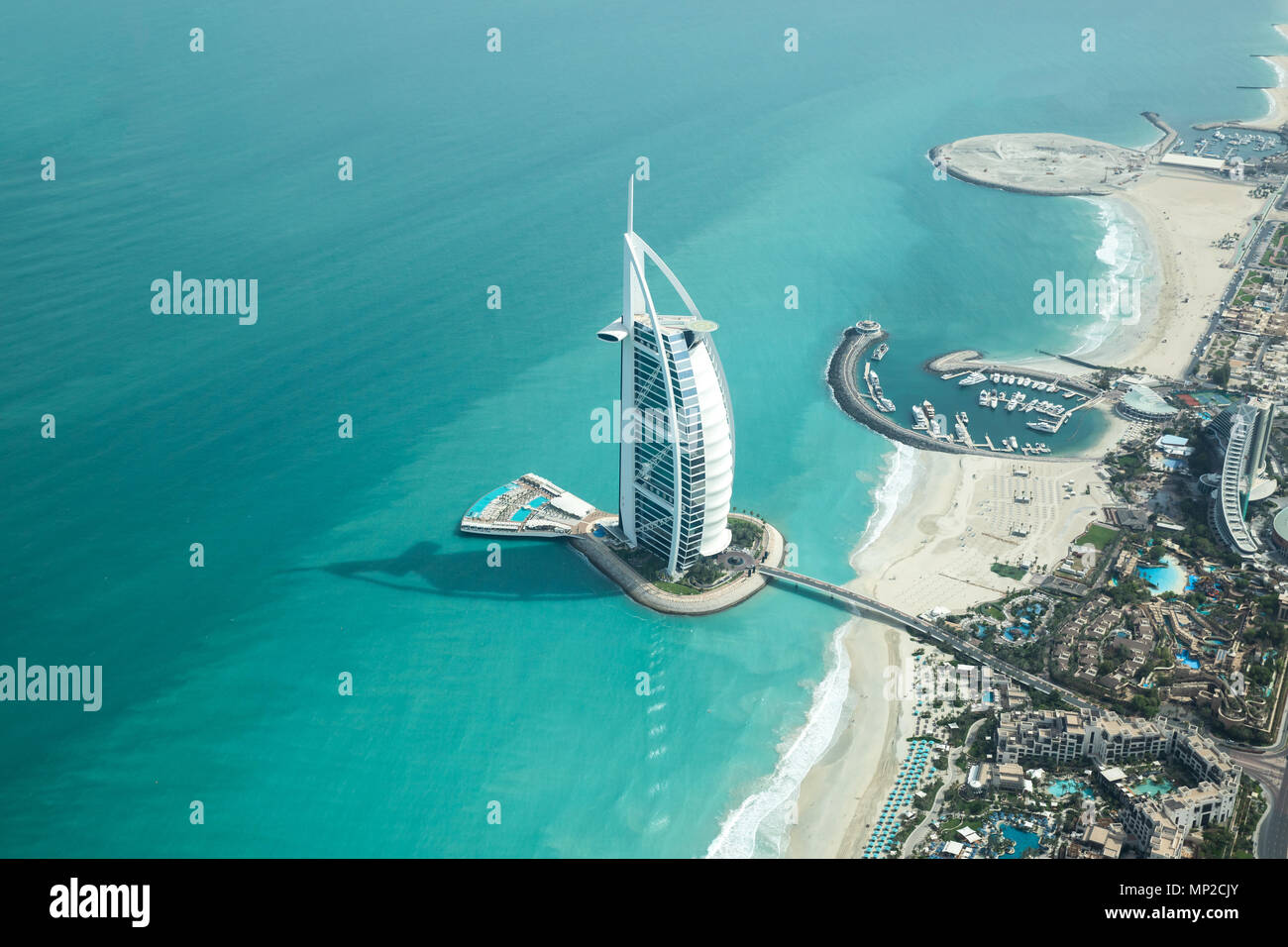 Dubai, UAE - May 18, 2018: Aerial view of Burj Al Arab luxury hotel on the coast of Persian Gulf on a clear sunny day. - Stock Image