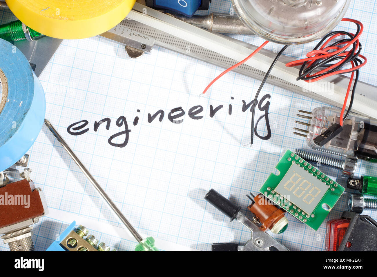 engineering radio electronic parts on graph paper background