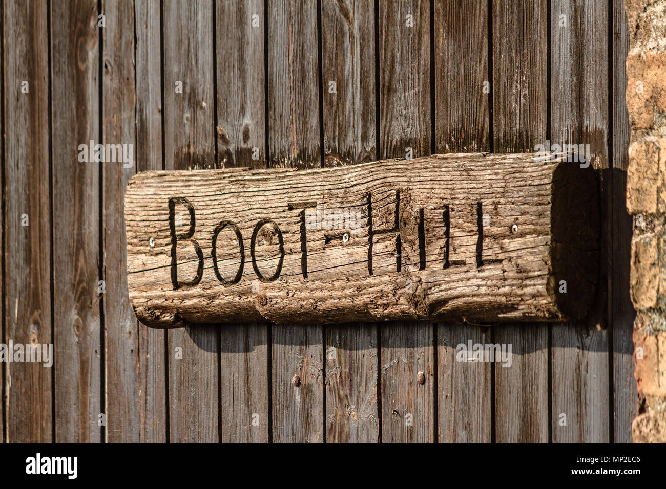 Wooden sign saying Boot Hill, Teignmouth, Devon. Feb 2018. - Stock Image
