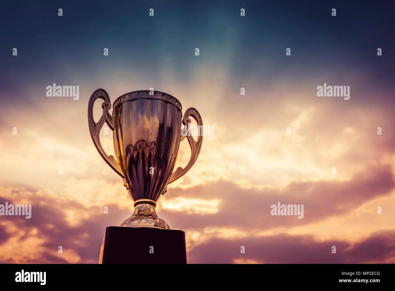 winner trophy on sky background - Stock Image