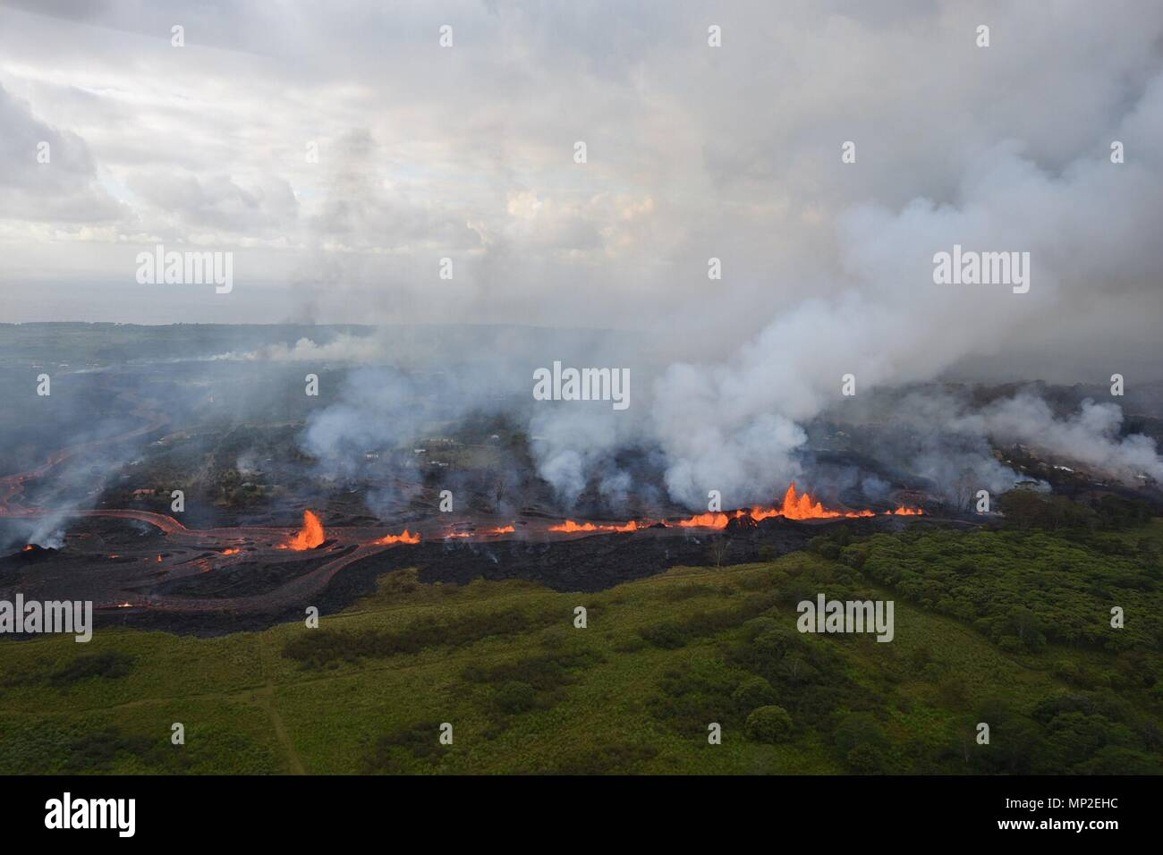 Lava fountains spew from fissure 20 caused by the eruption of the Kilauea volcano May 19, 2018 in Pahoa, Hawaii. Stock Photo