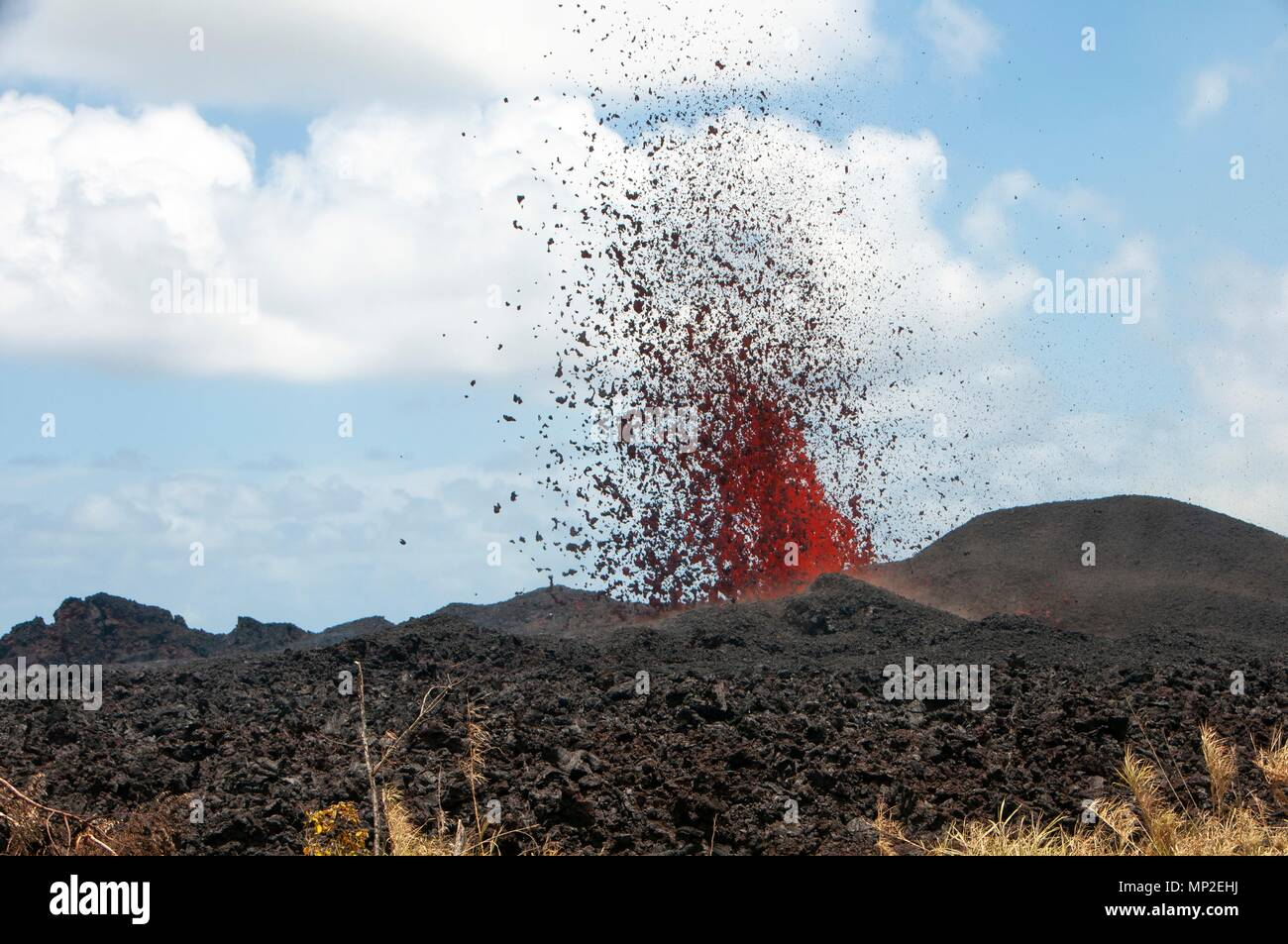 Lava spews out from fissure 17 caused by the eruption of the Kilauea volcano May 18, 2018 in Pahoa, Hawaii. Stock Photo