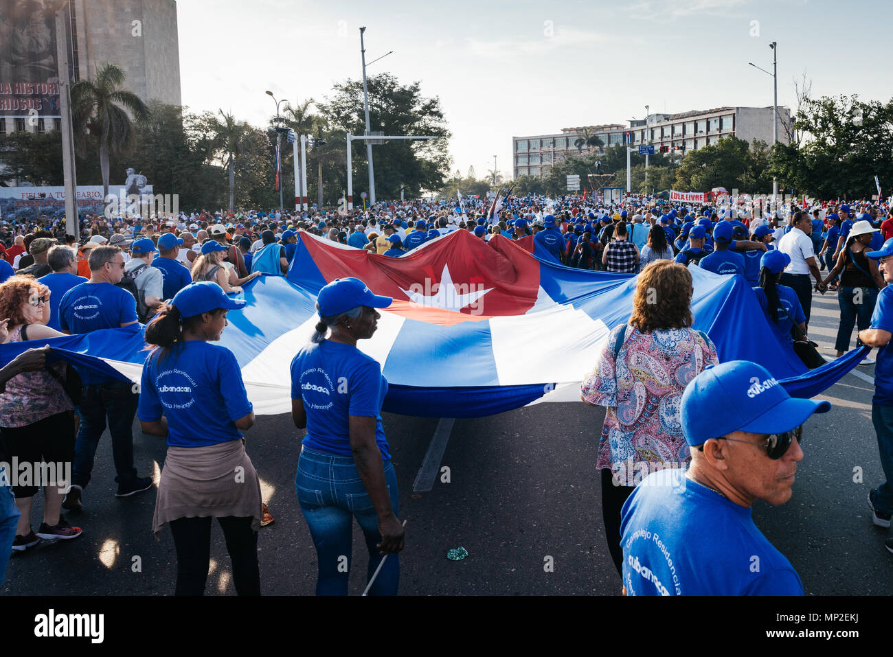 Havana, Cuba. May 1st 2018 Marchers in the International Worker's Day March  marching with the Cuban flag.  Caleb Hughes/Alamy Live News - Stock Image