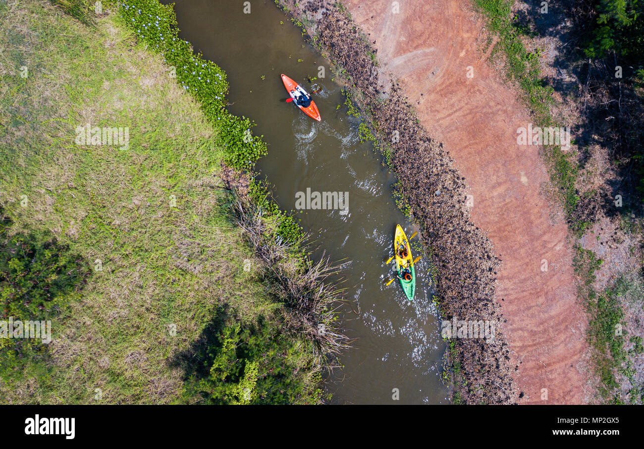A drone image taken of two kayakers on a river in Thailand Stock Photo