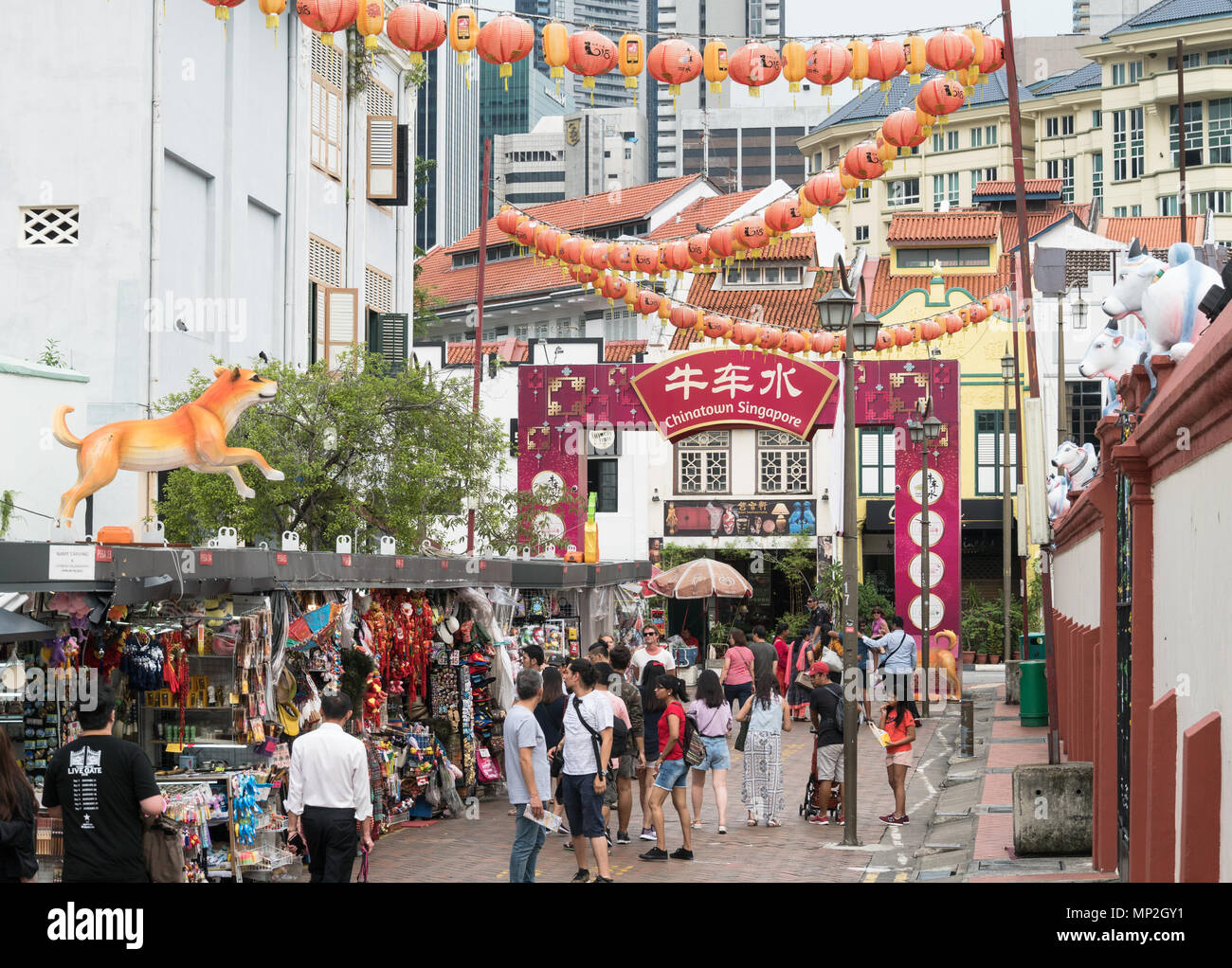 Singapore - April 23 2018: Tourists strolling around the various souvenir market stalls in Singapore Chinatown in Southeast Asia. - Stock Image