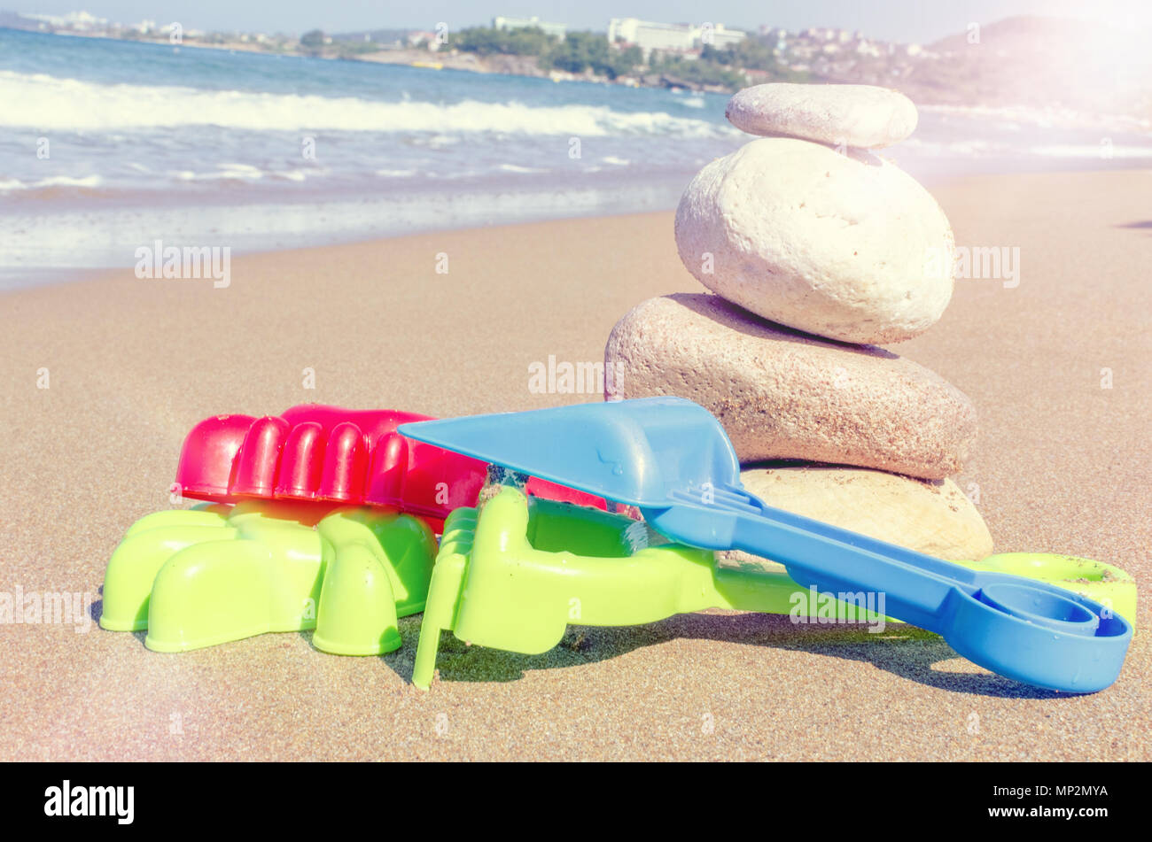 08f0f20c3276c Vacation image of children s beach toys and stones on the sand in beautiful  sunny day. Kids summer holidays activity concept. Copy space.
