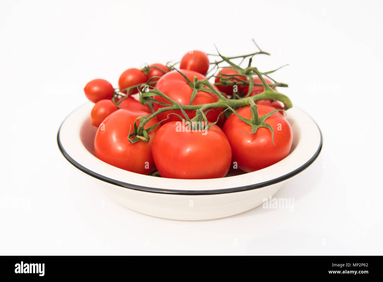 red vine tomatoes in white bowl - Stock Image