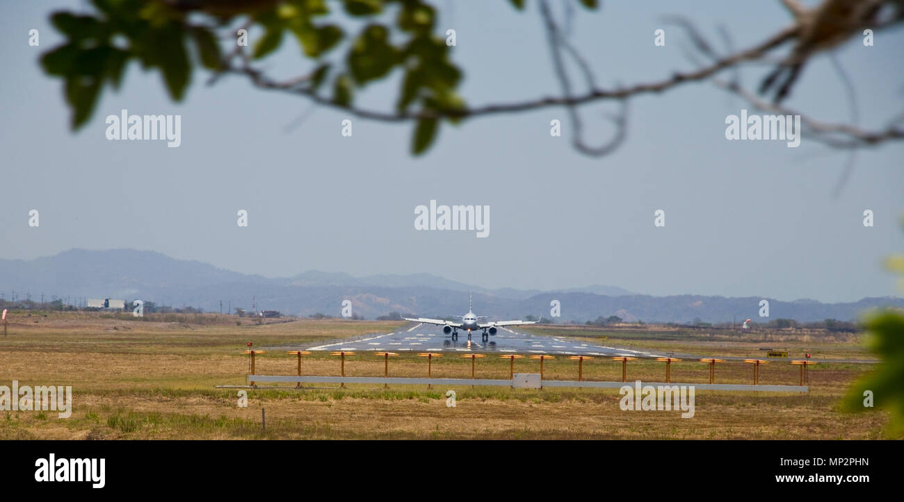 plane coming towards the camera on the runway in liberia - Stock Image