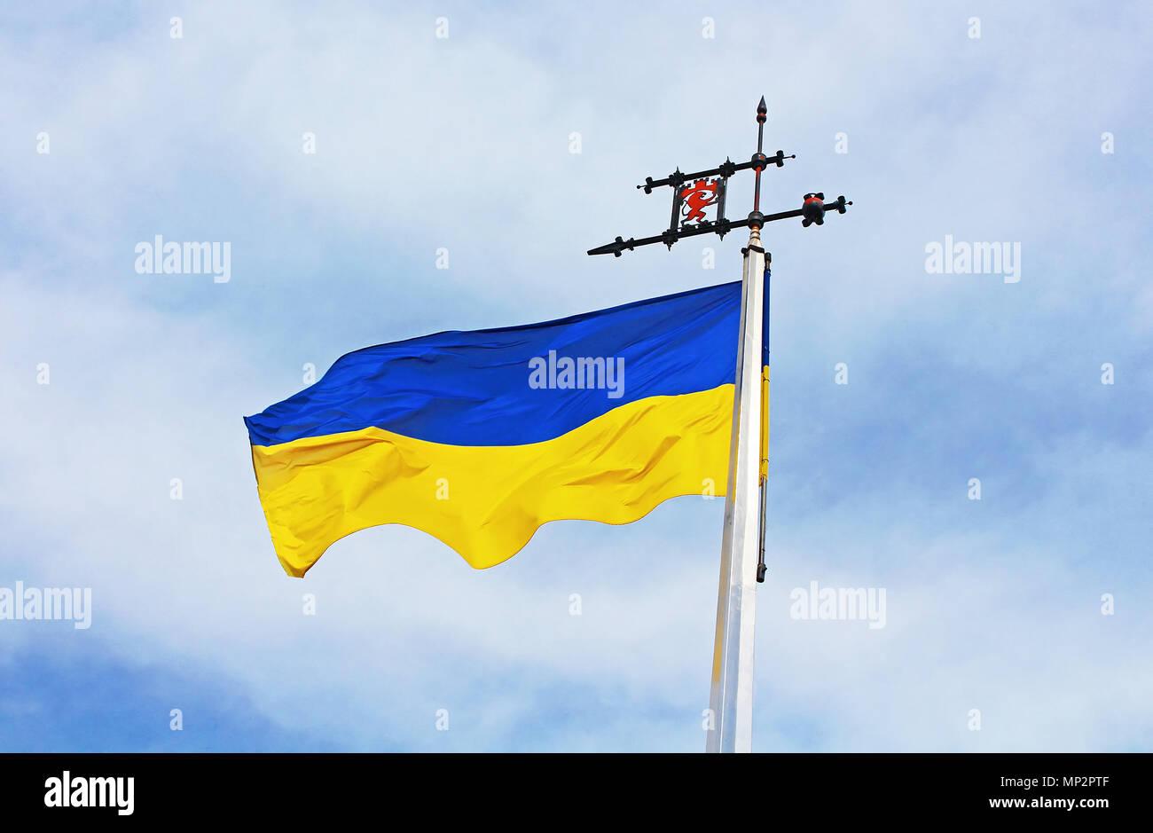 Ukrainian flag against blue sky Stock Photo