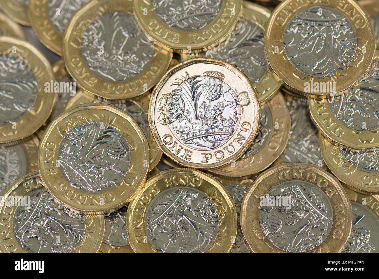 pile of pound coins from above - Stock Image