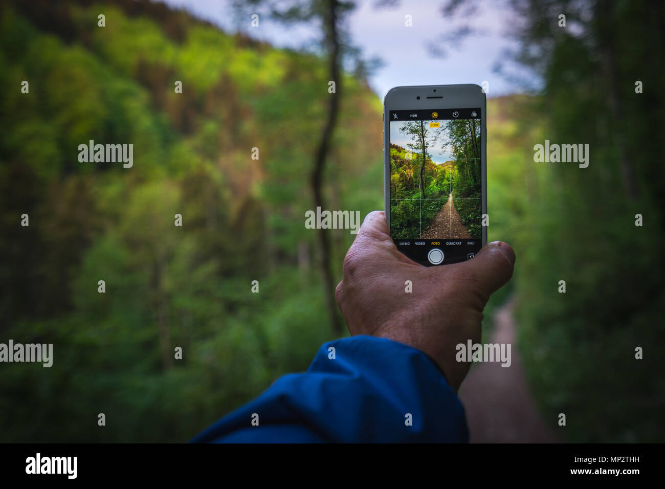 Take a photo with your mobile phone in the Wutachschlucht while hiking. - Stock Image