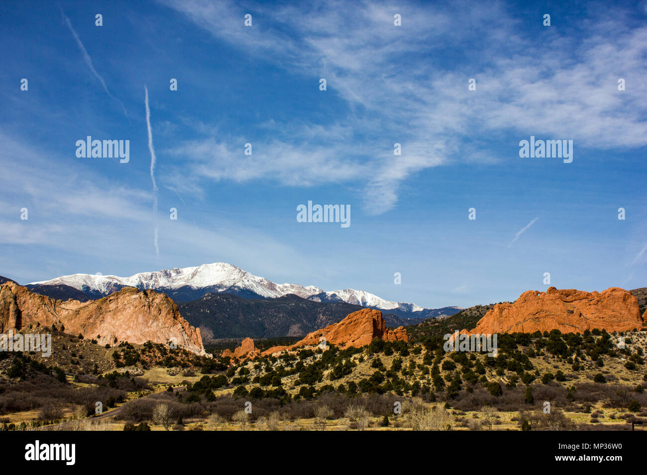 Clear blue sky and magnificent deep-red hue of sandstone at Garden of the Gods, Colorado Springs, Colorado, U.S - Stock Image