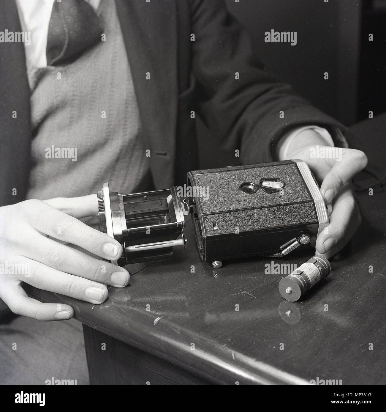 1950s, historical picture showing the camera unit or cartridge that holds the photographic 127 roll film of a kodak box camera, a 'Brownie', reflex, a popular camera model in this era, made in england from 1946 to 1960. - Stock Image