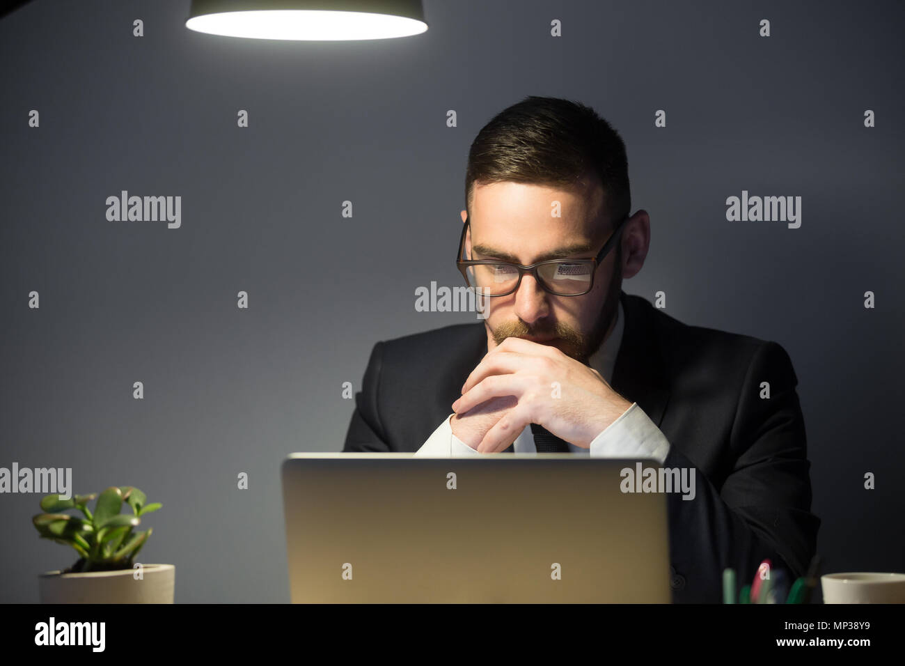 Concerned male thinking about company problem solution - Stock Image