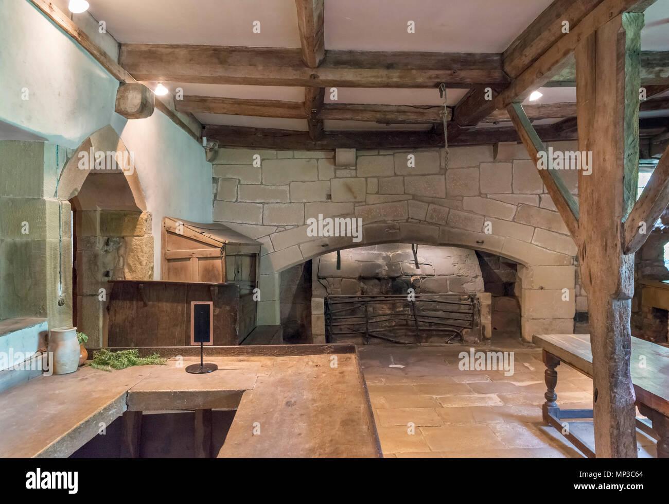 Tudor kitchen at Haddon Hall, near Bakewell, Derbyshire, England, UK - Stock Image