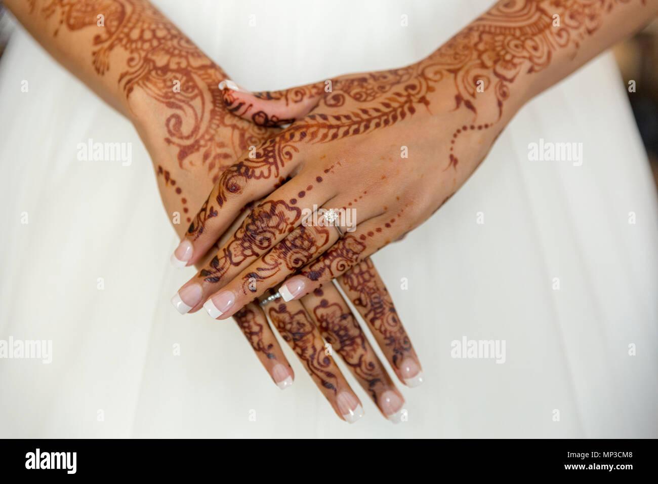 Mehandi Bride S Hands Against White Wedding Dress Stock Photo