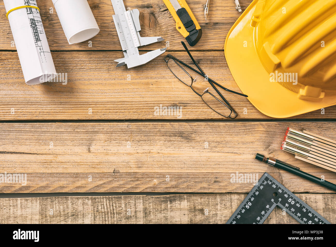 Architect workplace top view. Project construction blueprints and engineering tools on wooden desk, copy space - Stock Image