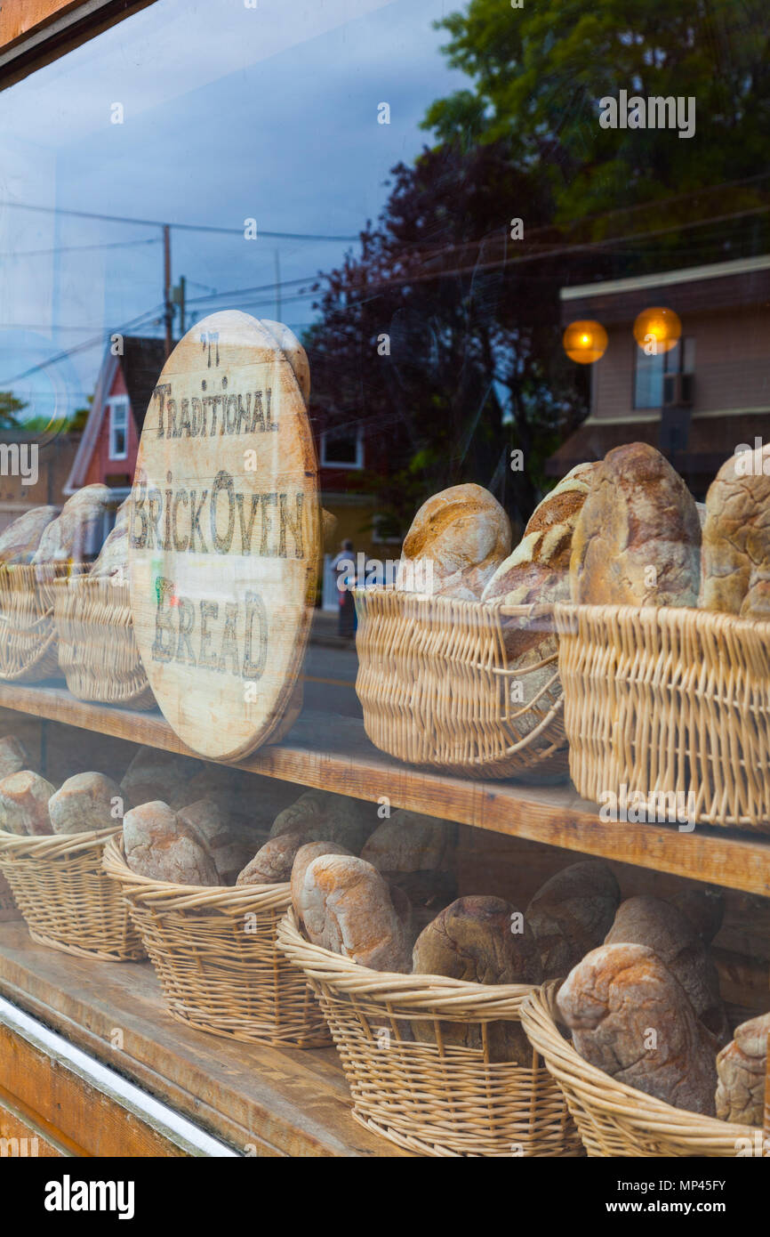 Artisan Bakery in Steveston using a large brick oven to bake the loaves - Stock Image