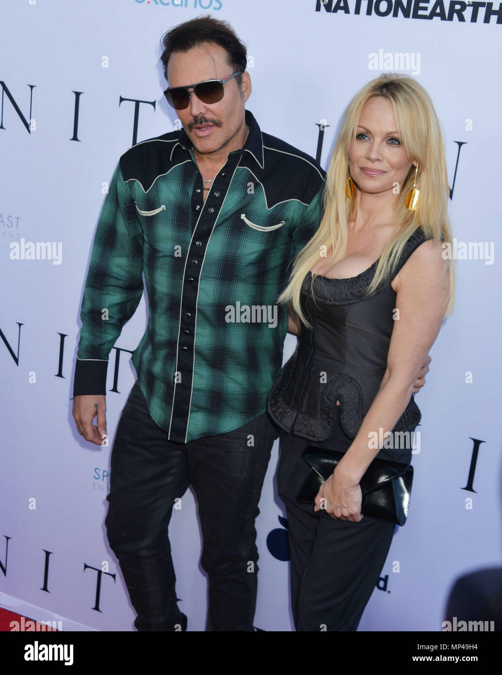 Pamela Anderson, David LaChapelle 009 at the Unity Premiere at the Director Guild Of America ( DGA ) Theatre in Los Angeles. June 24, 2015.Pamela Anderson, David LaChapelle 009 ------------- Red Carpet Event, Vertical, USA, Film Industry, Celebrities,  Photography, Bestof, Arts Culture and Entertainment, Topix Celebrities fashion /  Vertical, Best of, Event in Hollywood Life - California,  Red Carpet and backstage, USA, Film Industry, Celebrities,  movie celebrities, TV celebrities, Music celebrities, Photography, Bestof, Arts Culture and Entertainment,  Topix, vertical,  family from from the  - Stock Image