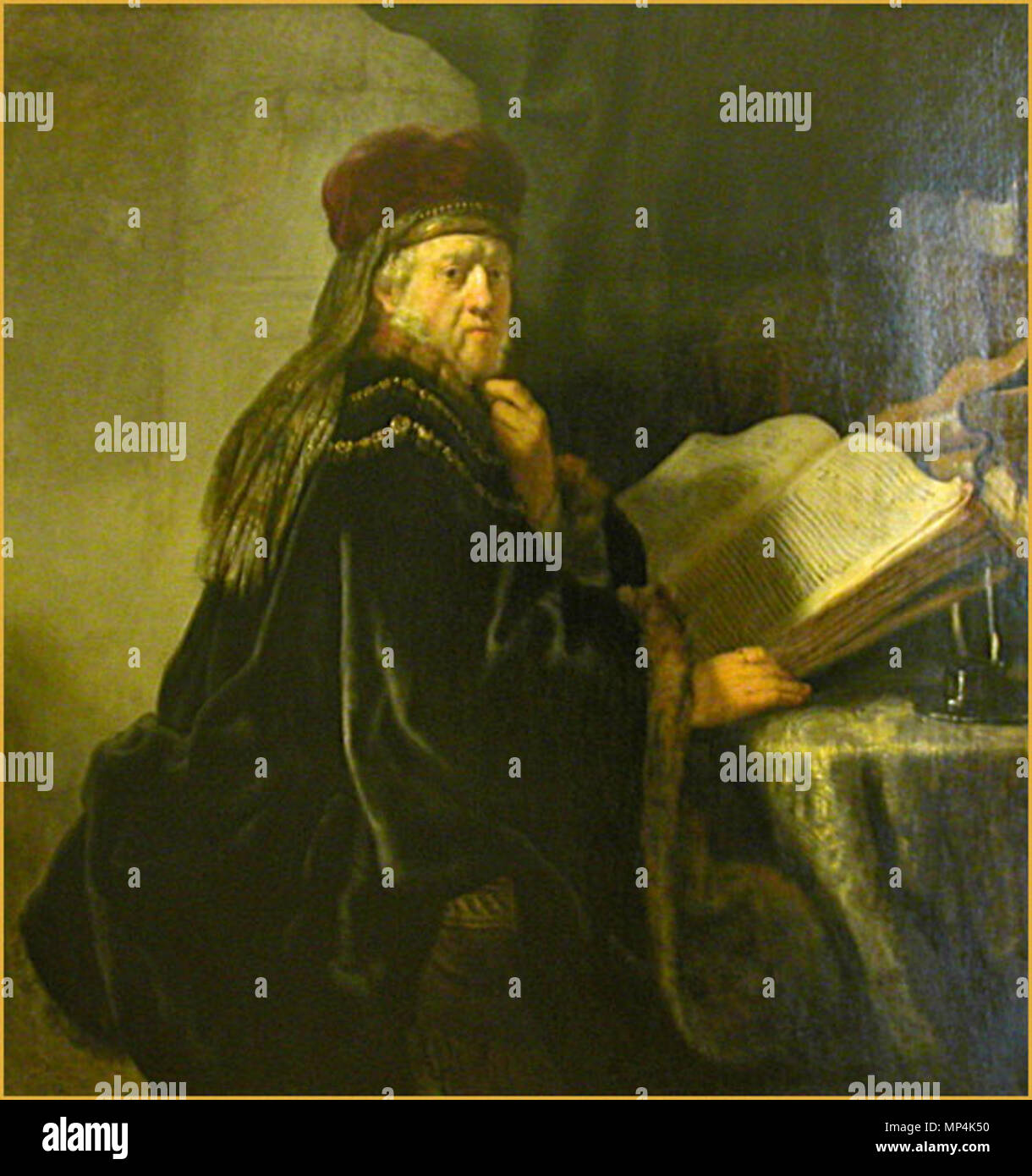 Le Rabbin ou le Savant dans son cabinet de Rembrandt (Galerie Nationale de Prague) Prague 2005 1052 Rembrandt, A Scholar Seated at a Table with Books, 1634, Prague Stock Photo