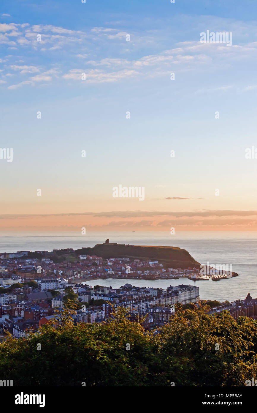 Scarborough's Castle headland and harbour at sunrise, seen from the summit of Oliver's Mount. Stock Photo