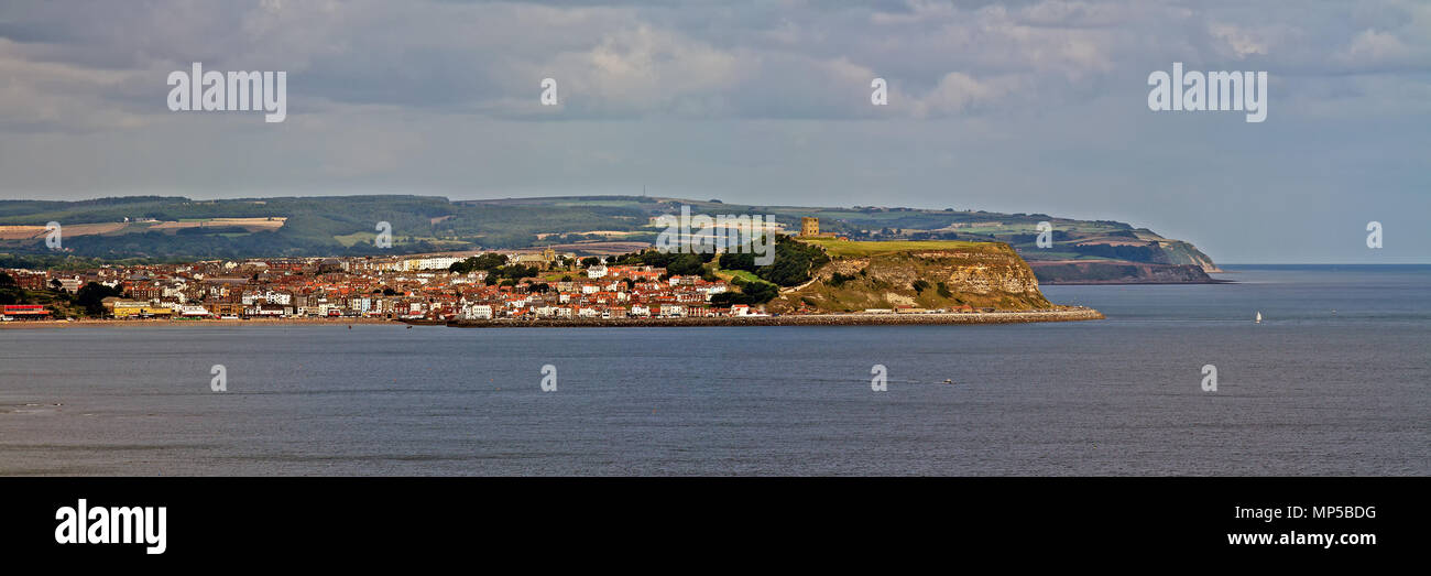 Scarborough's Castle headland, old town and South Bay seen from high on Gristhorpe Cliffs. - Stock Image