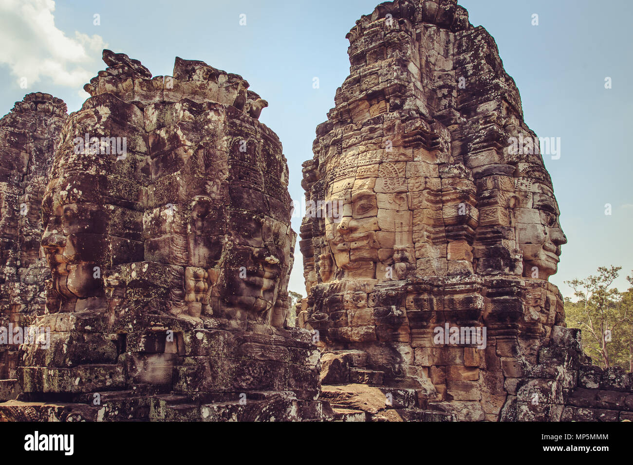 The many-faced temple Bayon is the pearl of the complex Angkor Thom. Siem Reap, Cambodia. - Stock Image