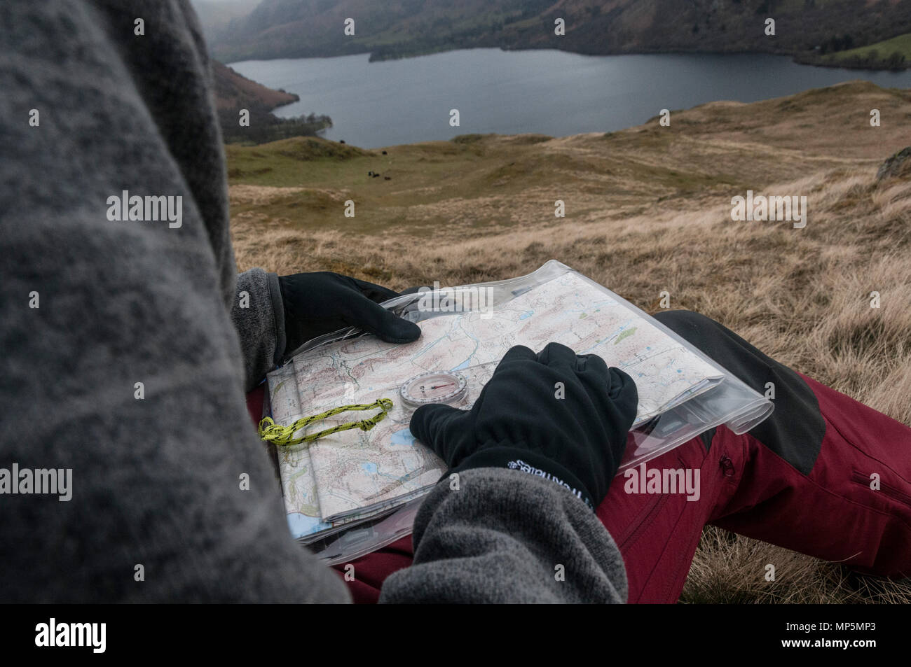 Walker using a compass and map to find way Stock Photo