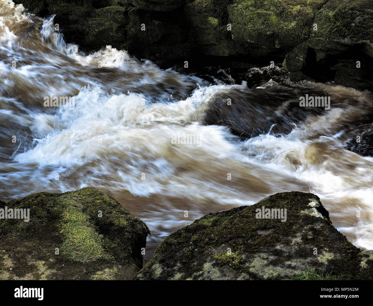 Patterns of power at The Strid, near Bolton Abbey, Yorkshire Dales - Stock Image
