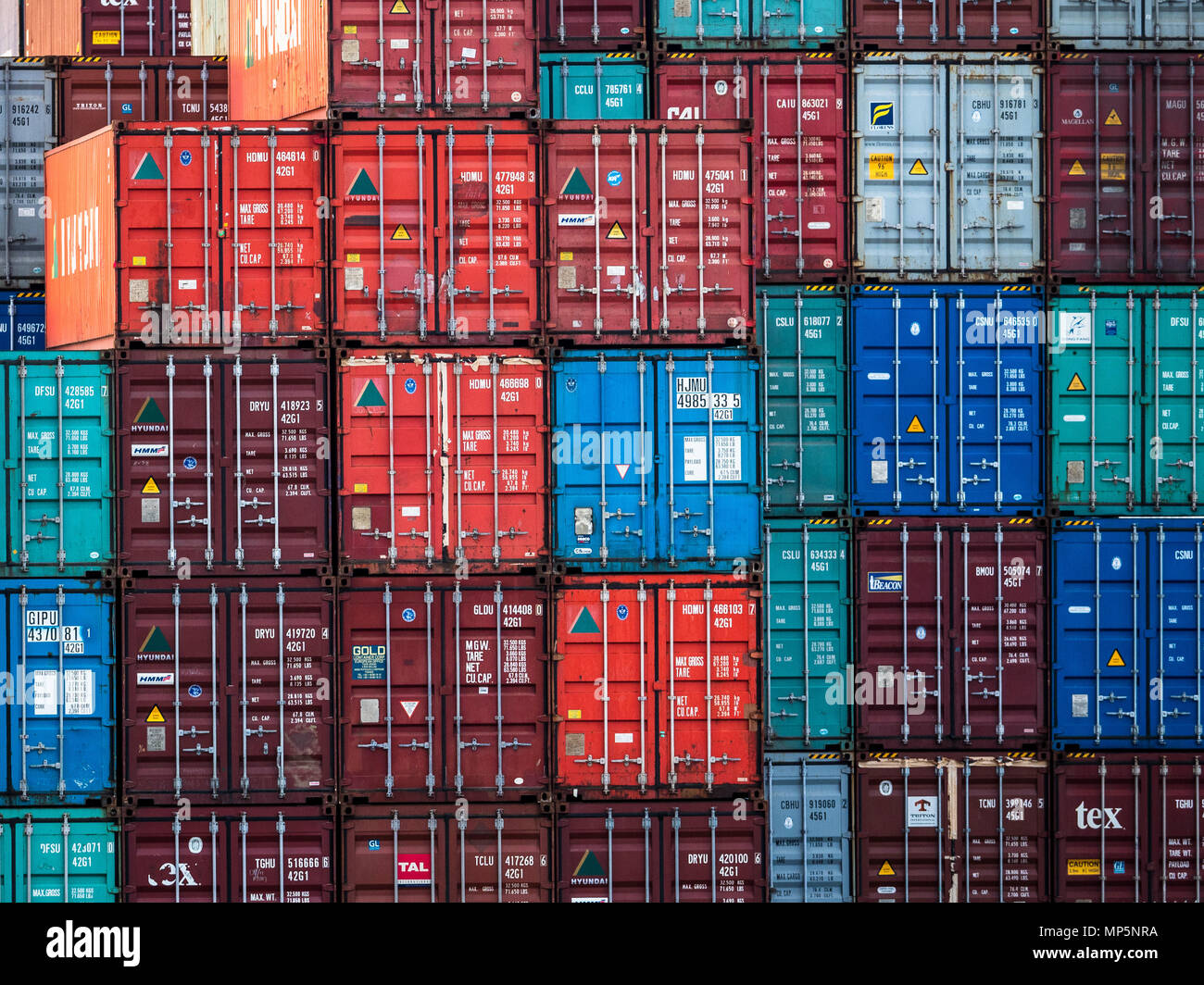 Global Trade - Shipping containers in transit between ports - Port of Felixstowe UK - Stock Image