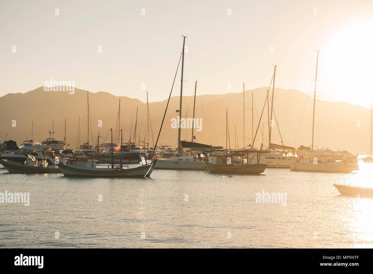 Sail boats moored at Ilhabela, SE Brazil - Stock Image