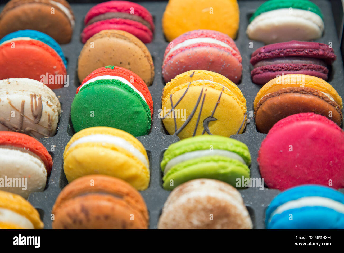 Colourful Macarons shot close up in landscape format. - Stock Image