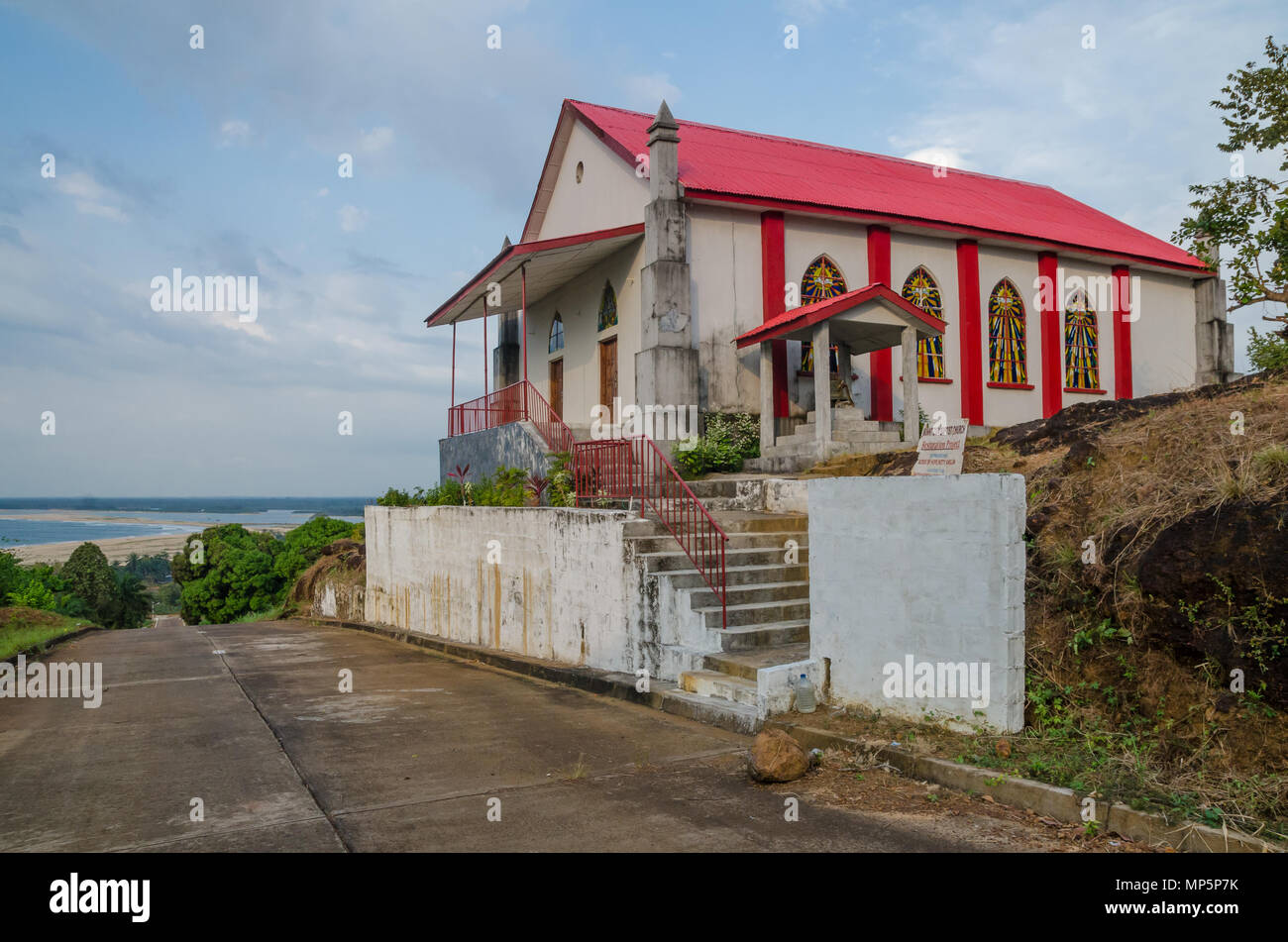 Mount Zion Baptist Church on top of hill with road leading to ocean - Stock Image