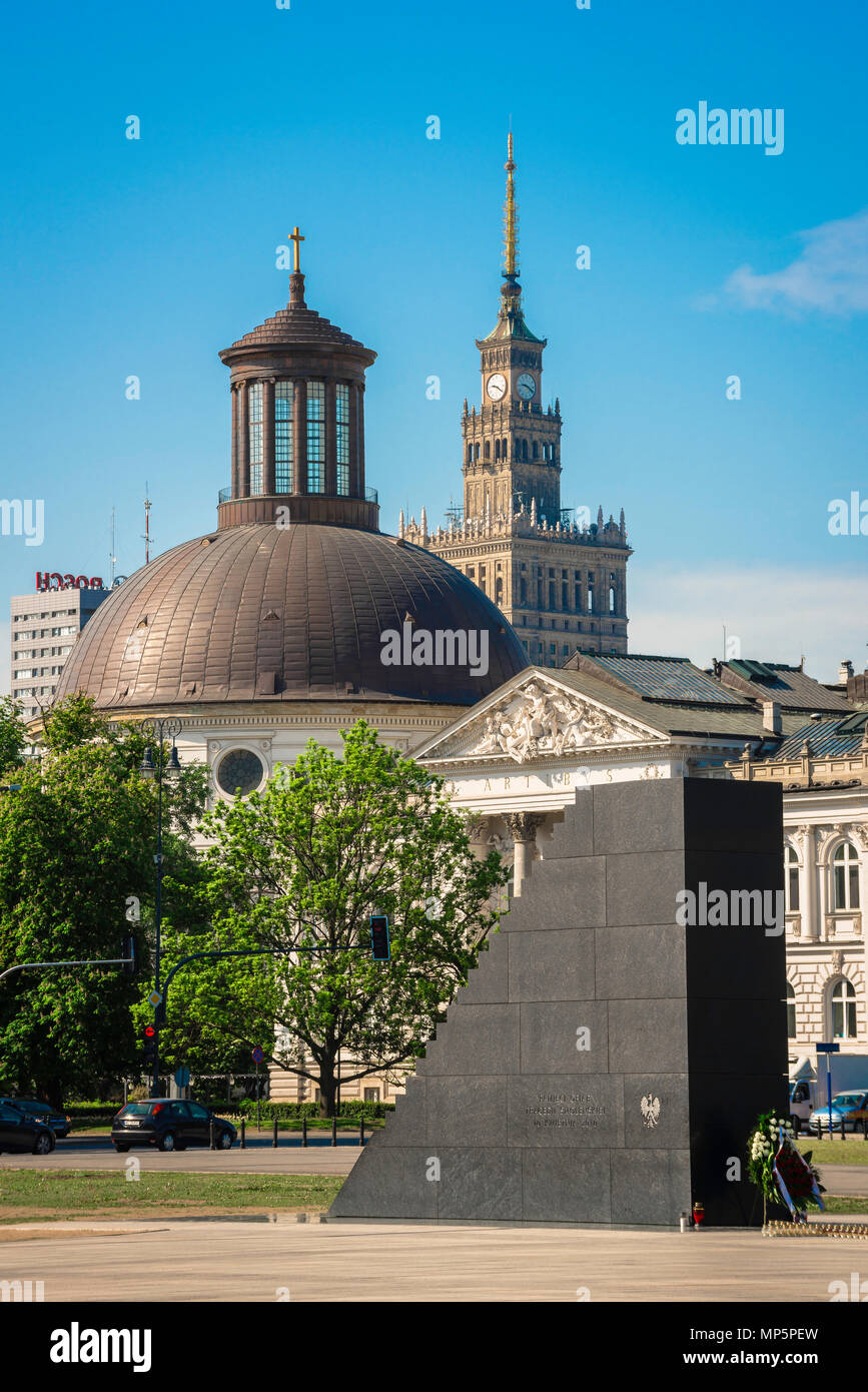 View of the Monument To The Victims Of The Smolensk Air Crash with the National Art Gallery, Lutheran Church and Palace Of Culture And Science behind. - Stock Image