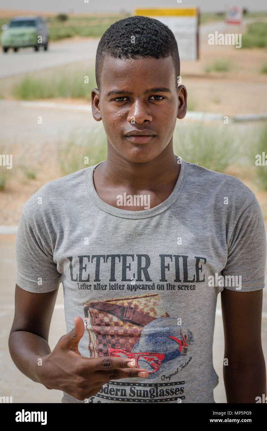 Nouadibhou, Mauritania - September 28, 2013: Portrait of unidentified young man with gray t-shirt posing - Stock Image