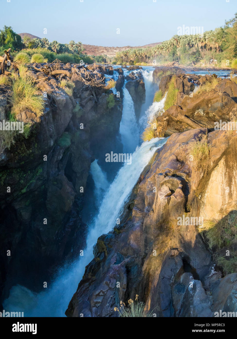 View over beautiful scenic Epupa Falls on Kunene River between Angola and Namibia in evening light, Southern Africa Stock Photo