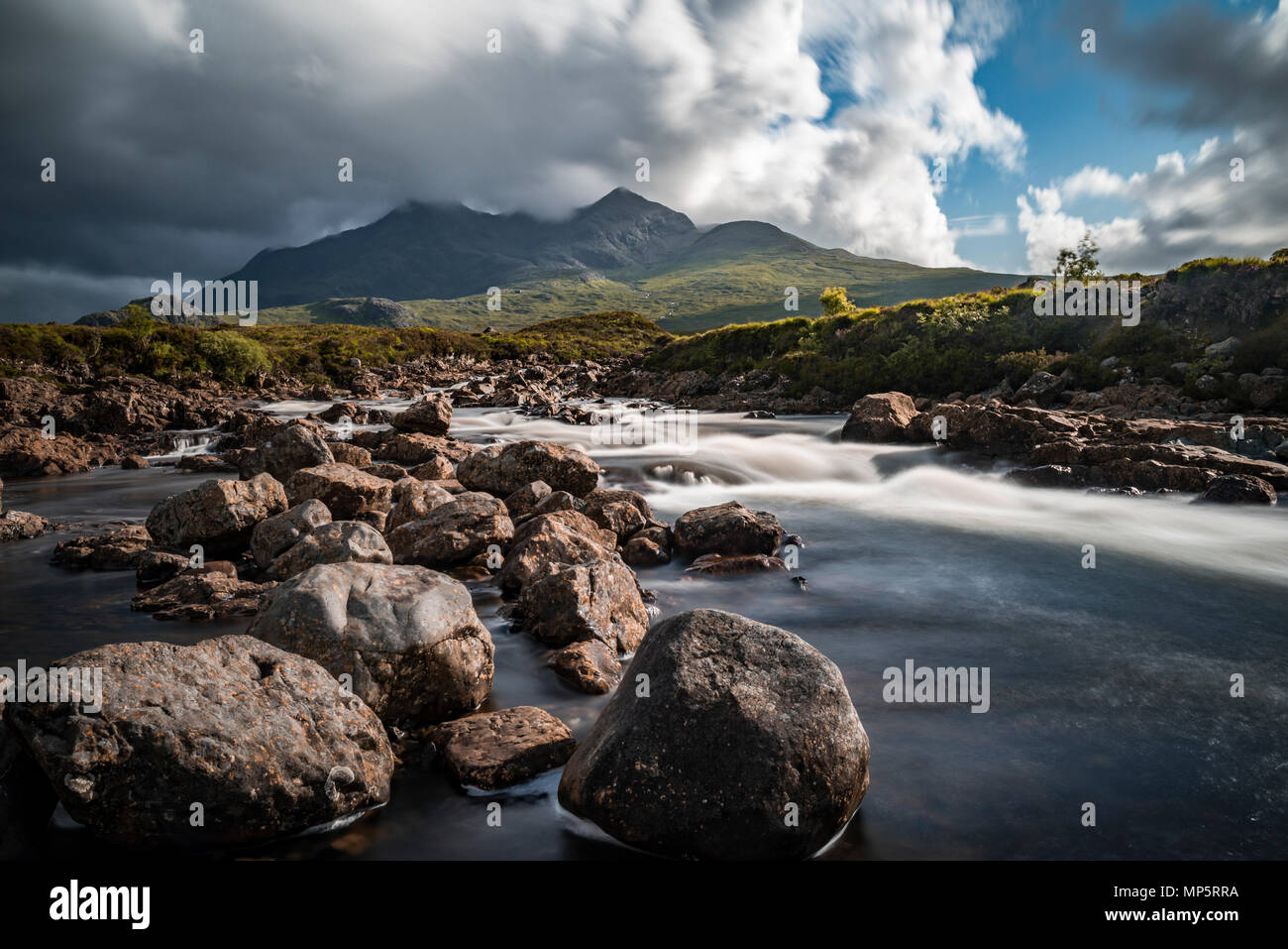 Scottish highlands - River Sligachan, Isle of Skye, Scotland, UK with the Black Cuillin mountains, Cuillins, in the distance - Stock Image